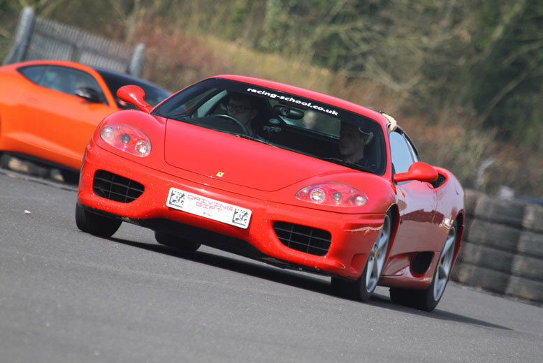 A red Ferrari on a race track