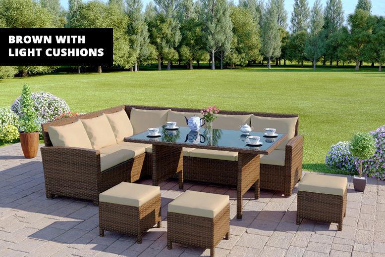 ffea1314a046 ... A brown rattan garden furniture set outside on a patio ...